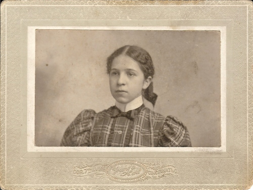 A mystery person (probably a relative) in a photograph taken at a studio at 7th and Vine St. in Cincinnati