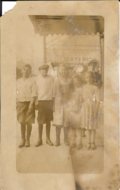 "Likely Cincinnati (check out the ""Queen City"" label on the inside of the overhang).  I think the second kid from the left is probably my great grandpa, but I'm not 100%."